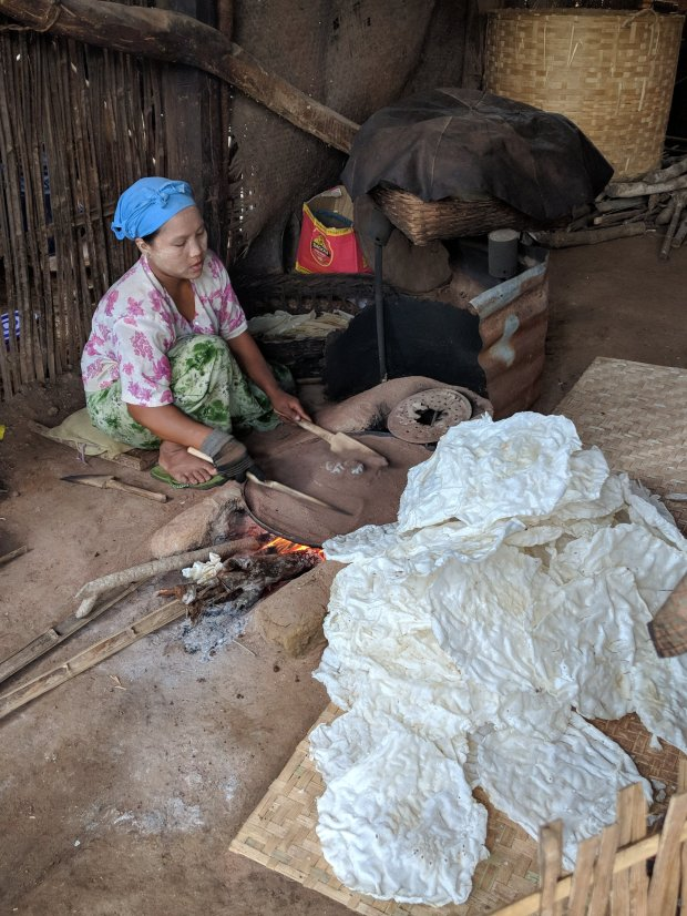 Making puffed rice cakes on hot sand in an Indein Village in Inle Lake
