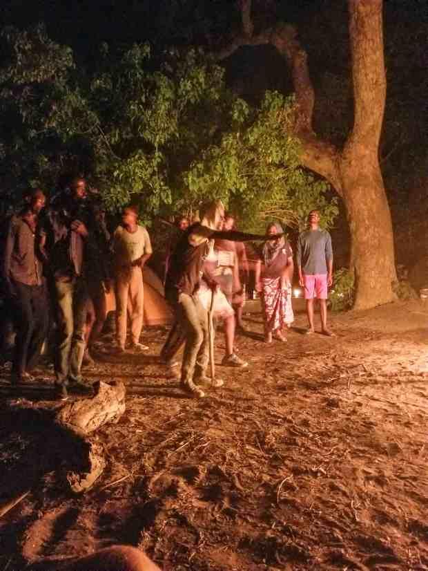 Singing and dancing around the campfire in the Okavango Delta Botswana