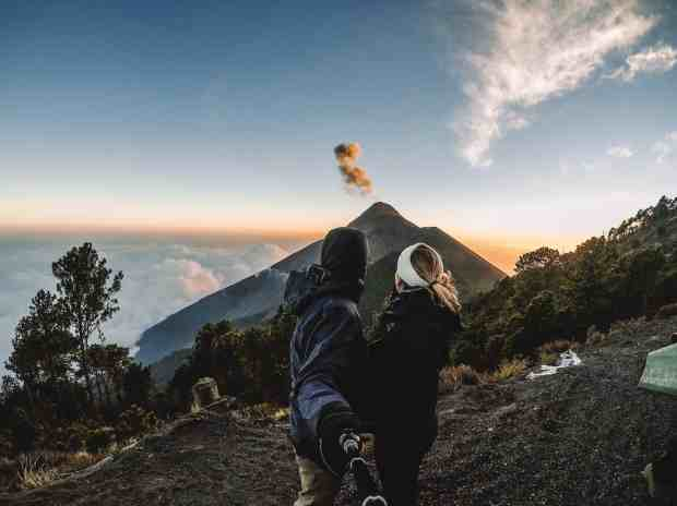Fuego Volcano erupts at sunset from Acatenango Volcano hike campsite