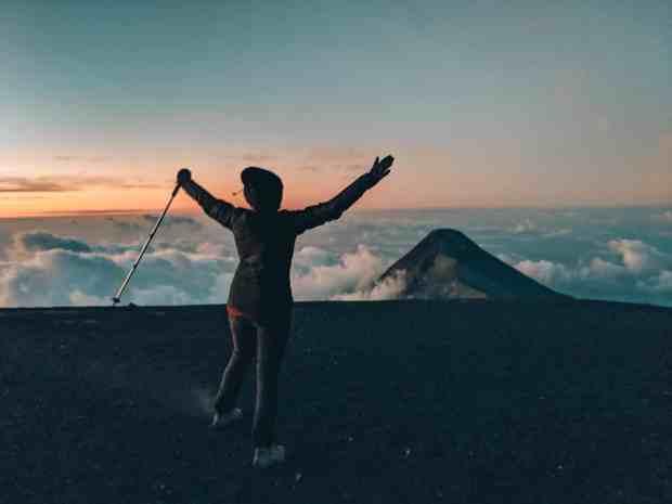 Sunrise over Fuego Volcano from the summit of Acatenango Volcano hike.