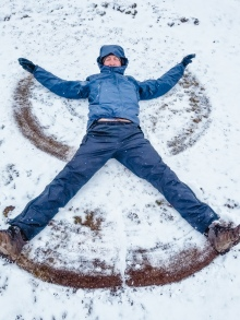 Tim making snow angels before the short hike to the van